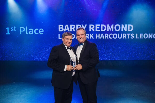 Barry Redmond receives the award for Top Rural Sales from Harcourts Managing Director, Mike Green